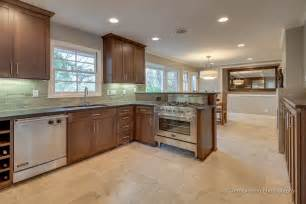 kitchen and dining room with travertine tile floor envision interiors