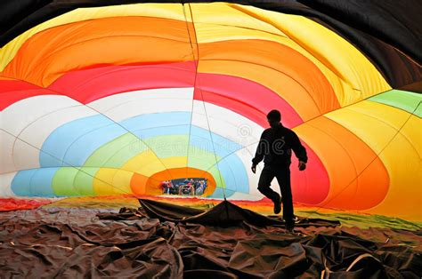 Man Inside A Colorful Hot Air Balloon Inflating Stock