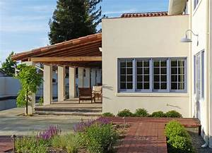 Mission style residential design with covered loggia ...