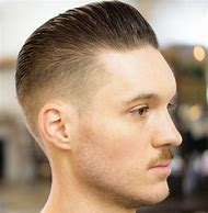 Fade with Slicked Back Hair