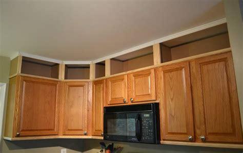 adding height to kitchen cabinets hmmm getting there add height to kitchen cabinets