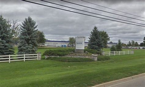 uaw reaches deal ends strike  michigan auto parts