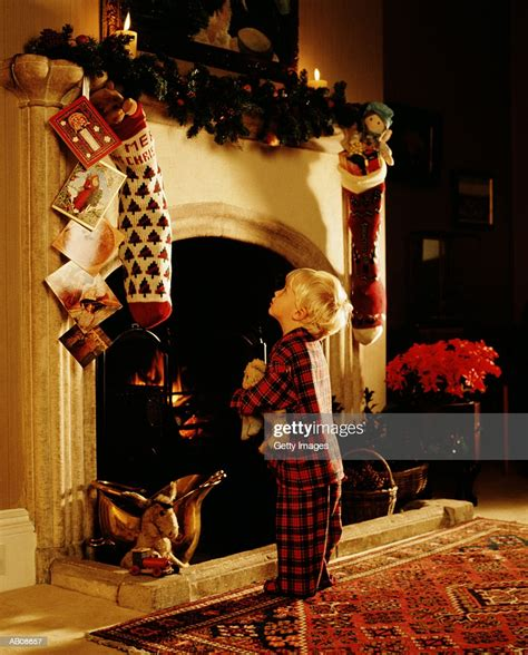 boy  front  fireplace hung  stockings christmas
