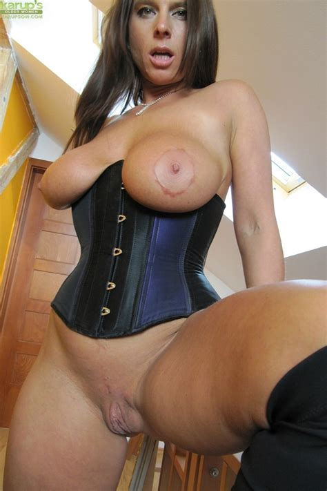 Big Titted Amateur Milf Susanne Poses In A Corset And Knee High Boots