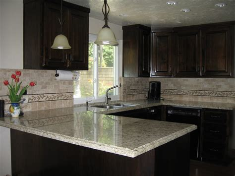 granite countertops with brown cabinets dark brown cabinets and giallo santo granite counter tops