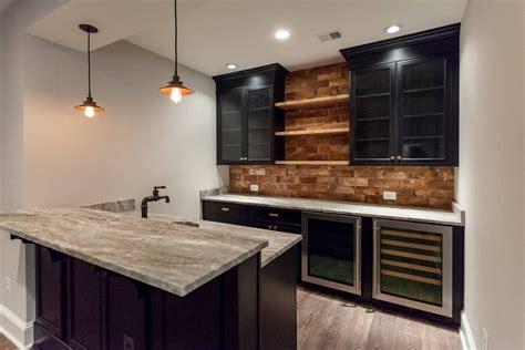 Basement Bar Backsplash by Basement Bar With Black Lacquered Cabinets And Brick