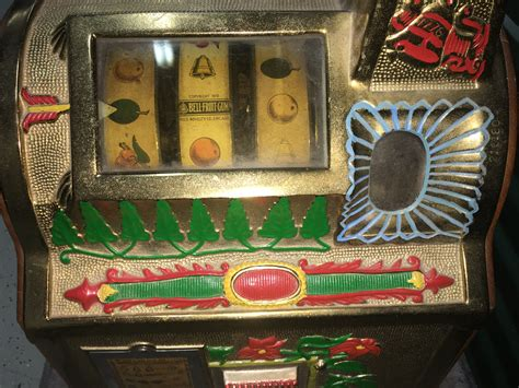 1931 Mills Golden Poinsettia Bell Slot Machine  Gameroom Show