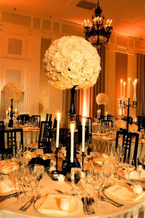 black white and gold centerpieces for wedding candlesticks lighting and on