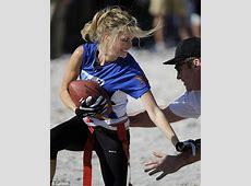 Victoria's Secret model Marisa Miller and Tom Arnold get