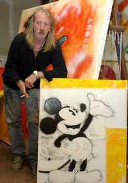 oostendse kunstenaar schildert met donald duck en  de standaard