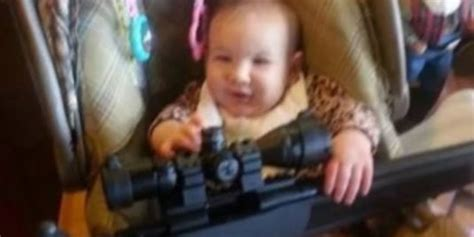 dad posts photo  baby  gun  people   pleased