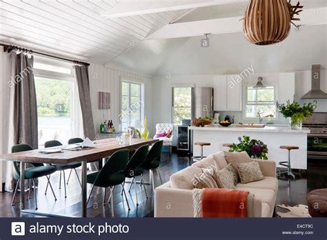 open plan white living space  ikea kitchen units