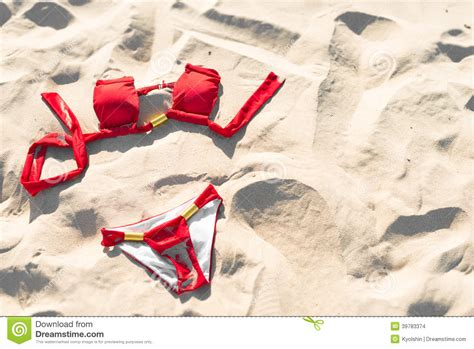red swimwear  sand holidays  vacations stock photo