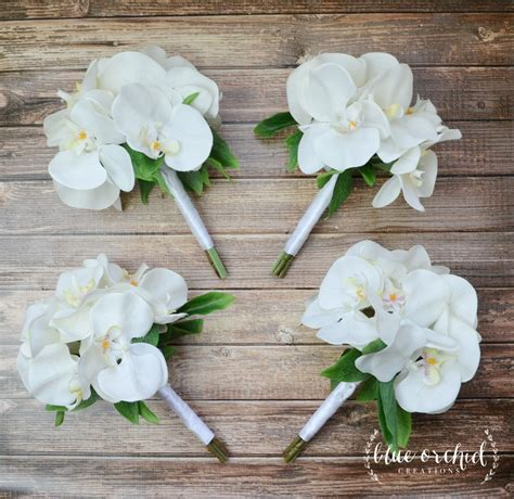 white orchid bridesmaid bouquets perfect  tropical