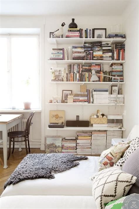 wall storage for small spaces small space secrets swap your bookcases for wall mounted shelving apartment therapy