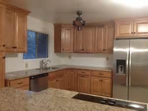 wolf saginaw cabinets with giallo amarillo countertop kitchen design ideas