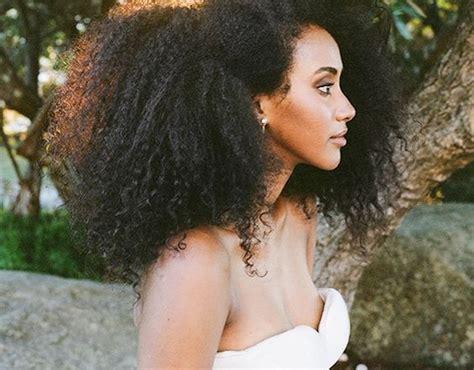 curls understood  big afro summer wedding hairstyles