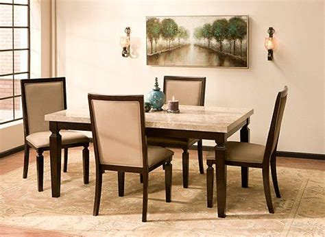 this rogue 5 piece marble dining set will make a beautiful