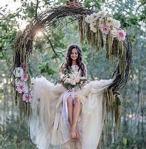 Picture Of a grapevine wreath with pink flowers used as a