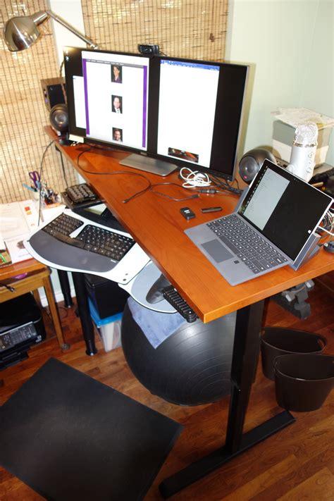 monitor office curved ultrawide desktop right desk front hand corner under sitting working