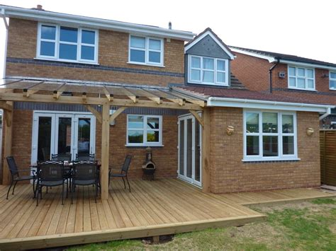 Extension With Part Covered Decking Finished With Oak