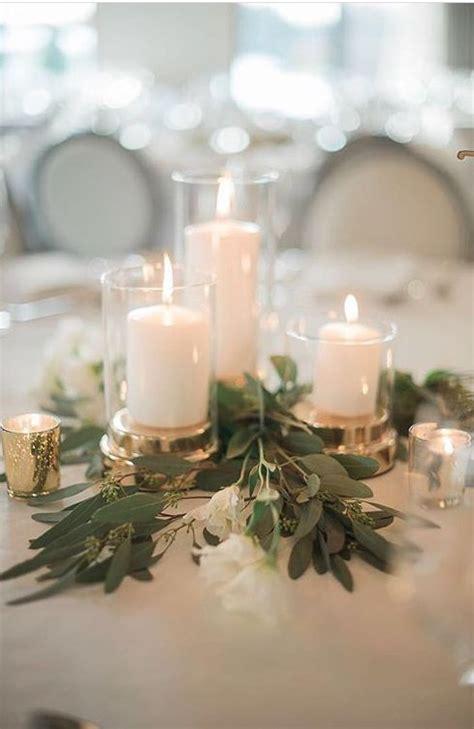 Rustikales Grün gesät Eukalyptus und Kerze Hochzeit