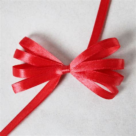 how to make a ribbon gift wrapping how to make a fancy bow using a comb loulou downtown