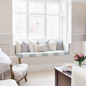 cream living room with window seat white shutters With window bench seat for a sweet living room