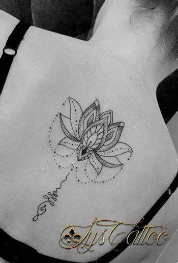 tatouage fleur de lys homme tattoo mandala lignes