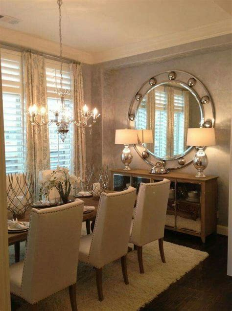Love this formal dining room great mirror lighting.   A
