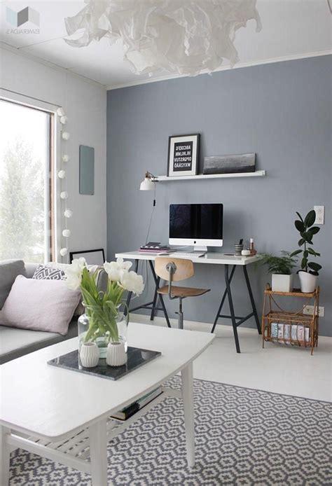 grey walls  area rug  white desks blue