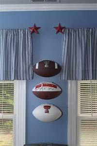 Footballs on the wall - stacked! INVISI-ball Wall Mount