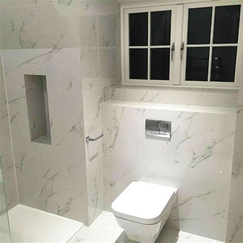 Carrara Marble Bathroom Floor by Bathrooms Walls And Floor Tiled With Carrara Marble Look