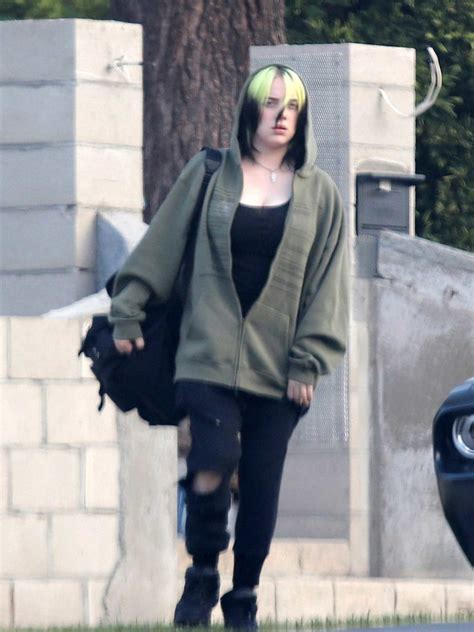 billie eilish   black ripped jeans