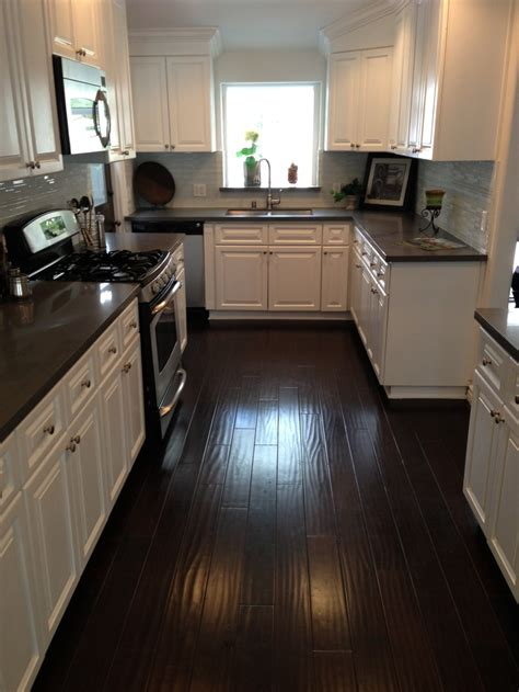 dark cabinets with wood floors kitchen dark counters dark floors white cabinets