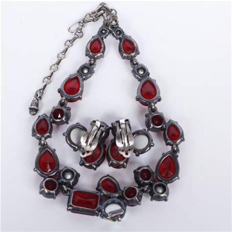 Schiaparelli Costume Jewelry Set; necklace & clip earrings;