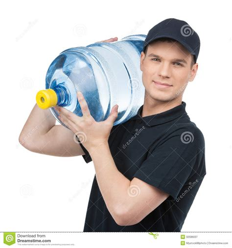 glass water pitcher with filter water delivery cheerful deliveryman holding a water