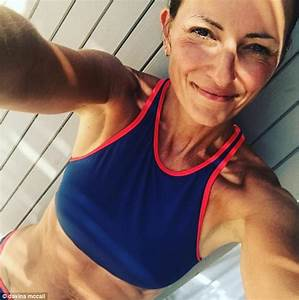 Davina McCall flaunts washboard abs in a bikini in Chester ...