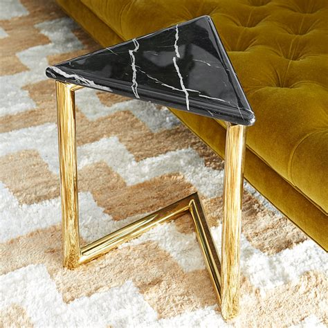 Pick out a fresh, white modern coffee table if you're all about futurism and minimalism all wrapped in one. Futuristic Glamour.A geometric riff on the c-table, the cantilevered design enables you to ...