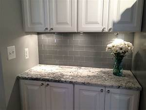 grey glass subway tile backsplash and white cabinet for With kitchen cabinets lowes with smokey and the bandit wall art