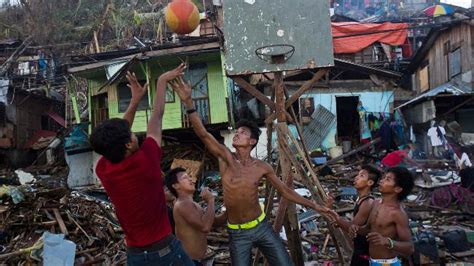 kids   philippines play basketball   ruins