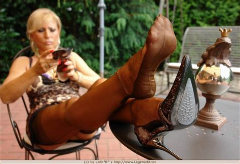 Leggy Lady Barbara In Brown Stockings And High Heels Pichunter