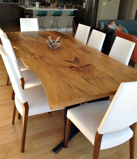 hand  bookmatched  edge sycamore dining table