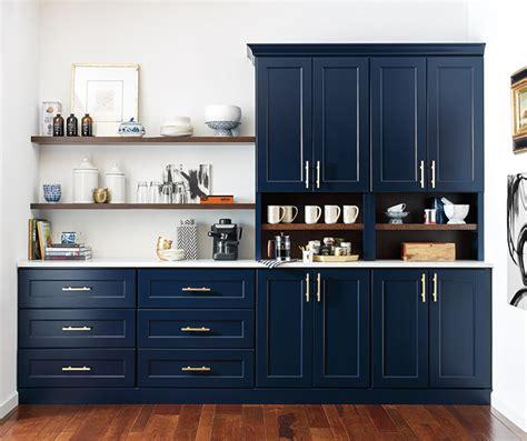 dark wood cabinets   blue kitchen island omega