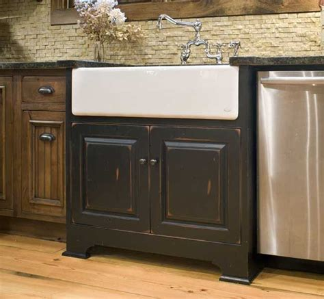 farmhouse sink cabinet ideas a white farmhouse sink with black sink base cabinet and