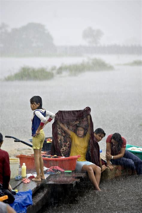picture children wash clothes torrential