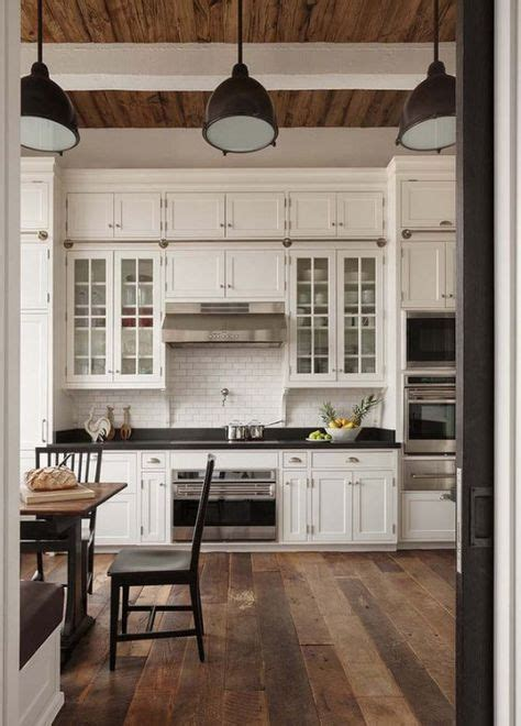 glass cabinets with solid cabinet doors on top love the