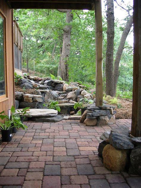 rustic backyard waterfall with pavers backyard and patios