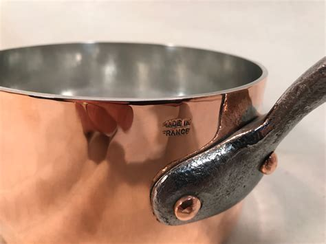 french hammered   copper tin lined sauce pan