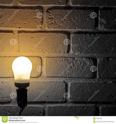 light bulb and brick wall stock 34294842